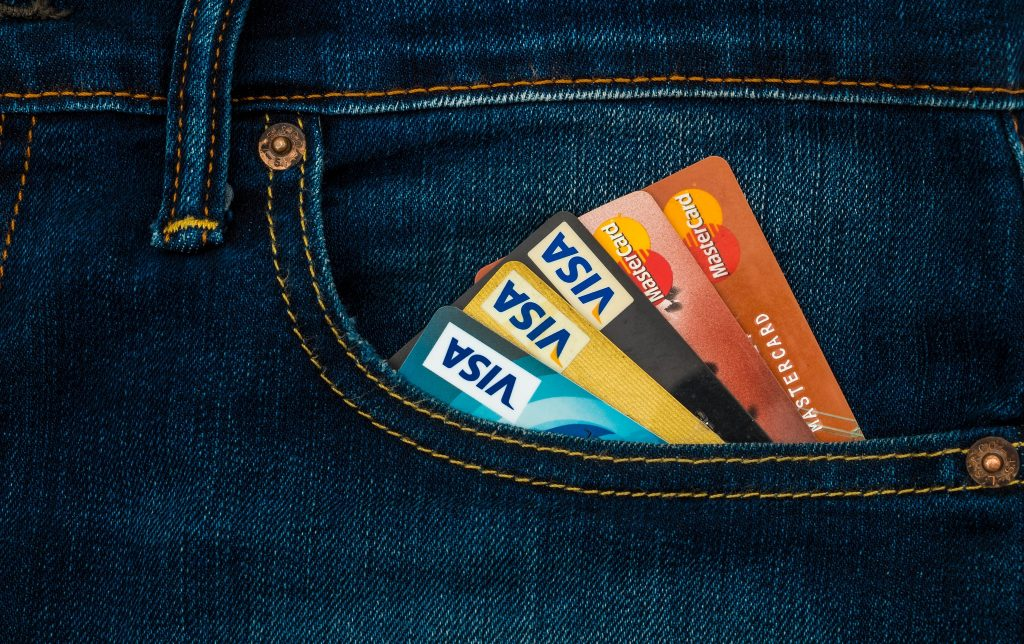 Maximize Cash Back and Points on Your Credit Cards, credit cards in jean pocket