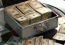 dollar banknotes in a suit case